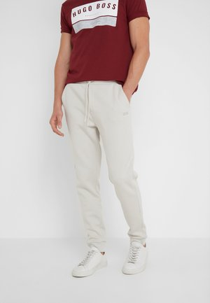 HADIKO  - Tracksuit bottoms - light beige