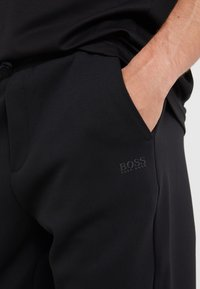 BOSS - HADIKO  - Pantalon de survêtement - black - 3