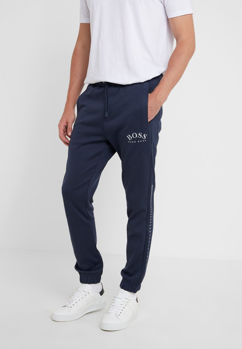 BOSS - HADIKO WIN - Tracksuit bottoms - navy/silver