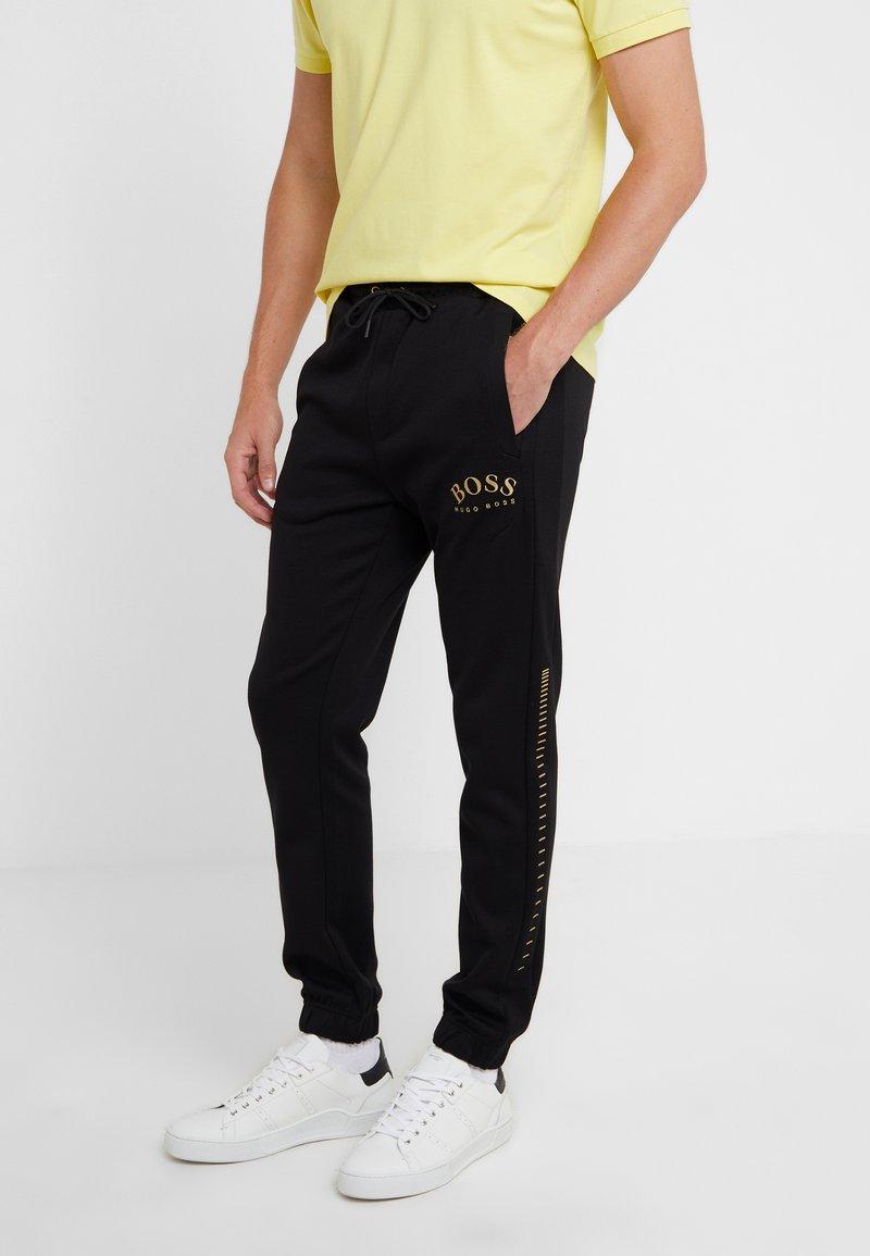 BOSS - HADIKO WIN - Pantaloni sportivi - black/gold