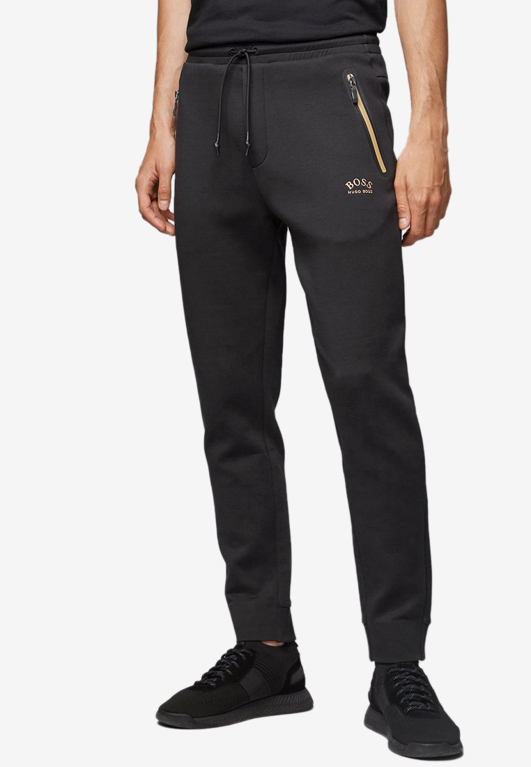 BOSS - HALBOA - Tracksuit bottoms - black/gold