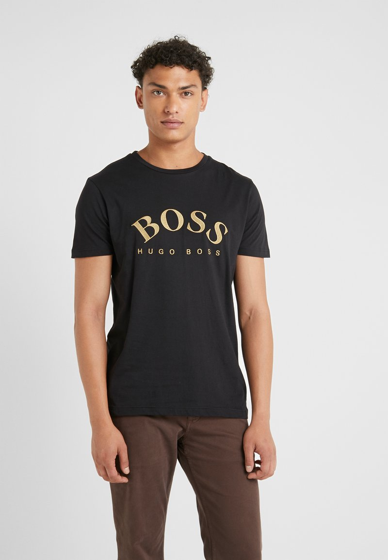 BOSS - T-shirts med print - black/gold