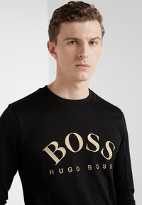 BOSS - SALBO 10217264 01 - Sweater - black/gold - 4