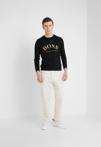 BOSS - SALBO 10217264 01 - Sweater - black/gold - 1