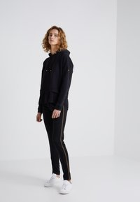 Barbour International - TRACK TROUSER - Tracksuit bottoms - black - 1