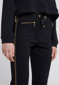 Barbour International - TRACK TROUSER - Tracksuit bottoms - black - 4