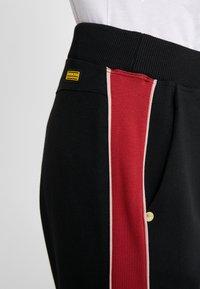 Barbour International - SPRINTER TROUSER - Tracksuit bottoms - black/rhubarb - 4