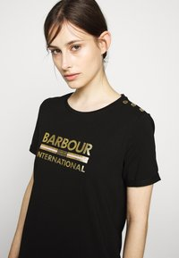 Barbour International - THUNDERBOLT DRESS - Žerzejové šaty - black - 4
