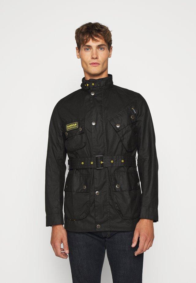 SLIM INTERNATIONAL WAX JACKET - Light jacket - black