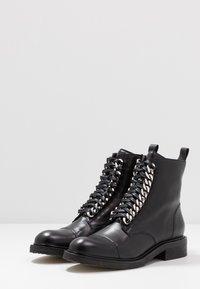 Billi Bi - Cowboy/biker ankle boot - black - 4