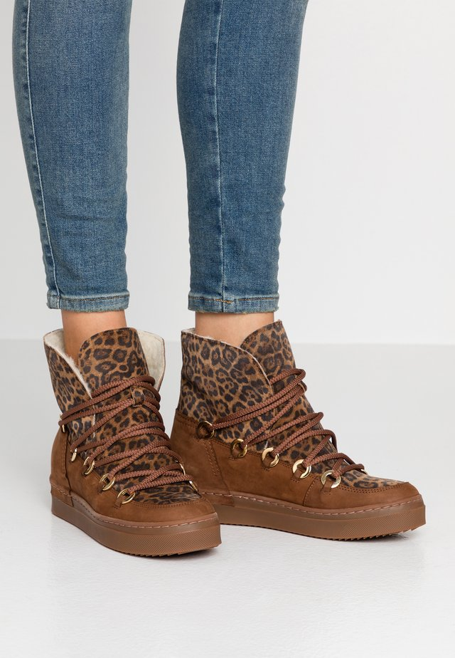 Ankle boots - brown/gold