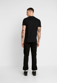 Bioworld - CLOCKWORK TEE - Triko s potiskem - black - 2