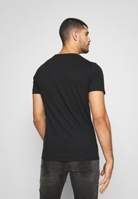 Bioworld - FRIENDS LOGO TEE - Triko s potiskem - black - 2