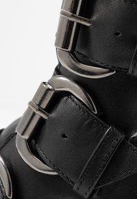 Bianco - BIACECILE TRIPLE BUCKLE BOOT - Cowboy/biker ankle boot - black - 2