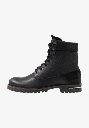 KENN - Šněrovací kotníkové boty - black