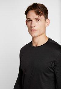 Björn Borg - TEE AXTON - T-shirt de sport - black beauty melange - 3