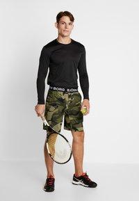 Björn Borg - TEE AXTON - T-shirt de sport - black beauty melange - 1