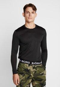 Björn Borg - TEE AXTON - T-shirt de sport - black beauty melange - 0