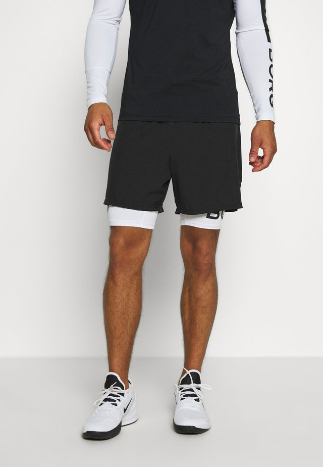 ANGO - Sports shorts - black beauty