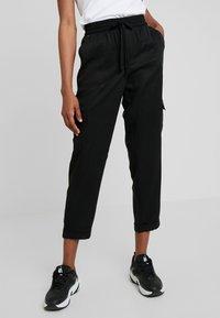Banana Republic - CARGO UTILITY - Pantalones deportivos - black - 0