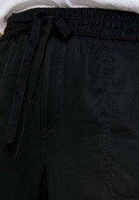 Banana Republic - CARGO UTILITY - Pantalones deportivos - black - 5