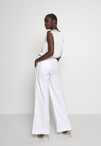 Banana Republic - WIDE LEG FULL LENGTH CLEAN SOLIDS - Trousers - white