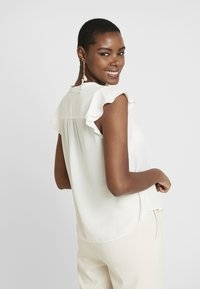 Banana Republic - FLUTTER SLEEVE TIE NECK SOLIDS - Blouse - snow day - 2