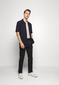 Banana Republic - AIDEN - Trousers - black - 1