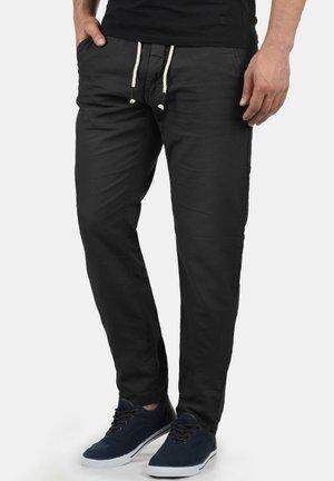 LANIAS - Trousers - black
