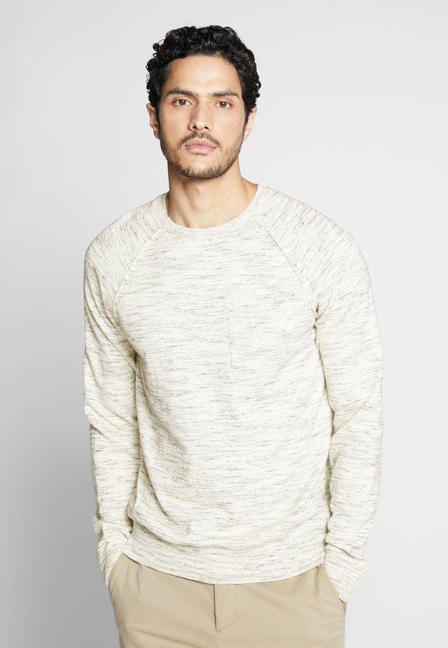 Stickad tröja - bone white