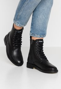 Blackstone - Lace-up ankle boots - black - 0