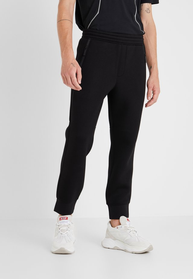 ELONGATED ZIP  - Tracksuit bottoms - black