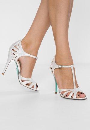 TEE - Sandalen met hoge hak - silver glitter