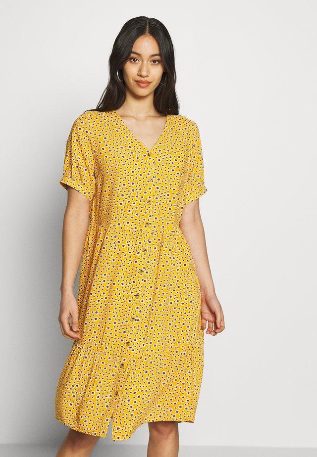 Korte jurk - golden glow