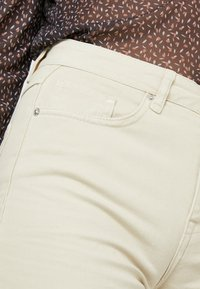 BLANCHE - ALIA CLEAN PANTS - Flared Jeans - moss gray - 5
