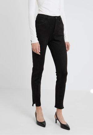 SACHIARA - Trousers - black