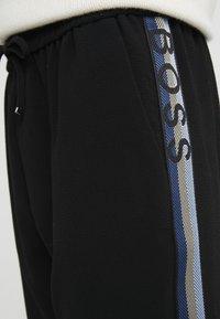 BOSS - SAFALIR - Pantalon de survêtement - black - 4
