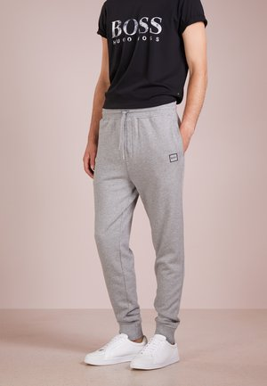 STRIKER - Tracksuit bottoms - light pastel grey