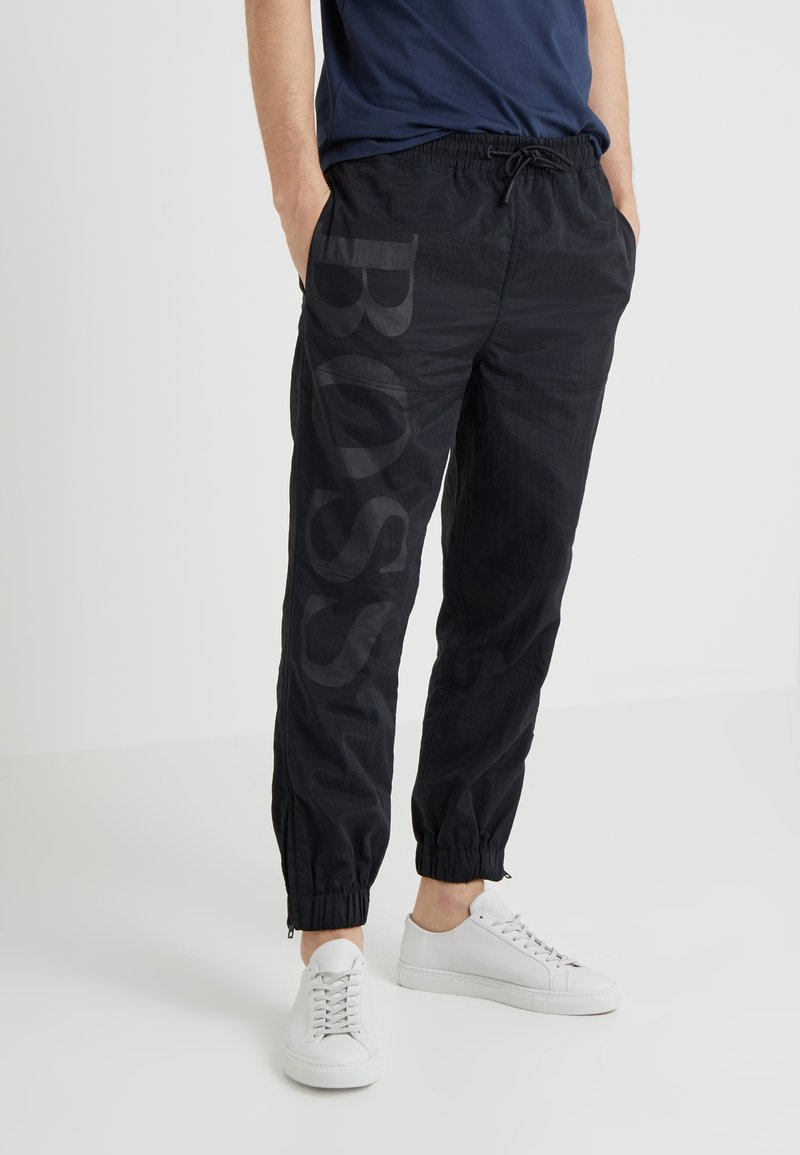 BOSS - SALTY - Tracksuit bottoms - black
