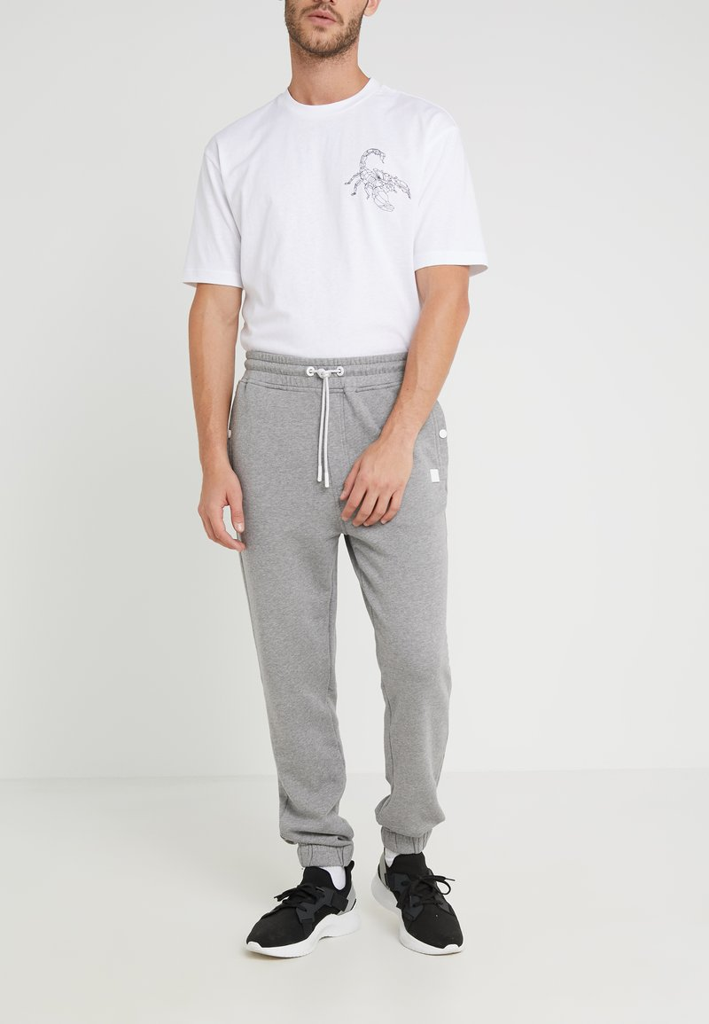 BOSS - SKYMAN - Tracksuit bottoms - light pastel grey