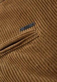 BOSS - Trousers - open beige - 4