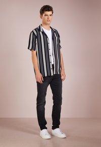 BOSS - TABER - Slim fit jeans - black - 1
