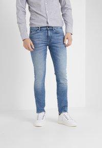 BOSS - DELAWARE  - Slim fit jeans - light blue denim - 0