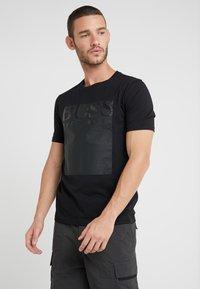 BOSS - TAUCH - T-shirt imprimé - black - 0