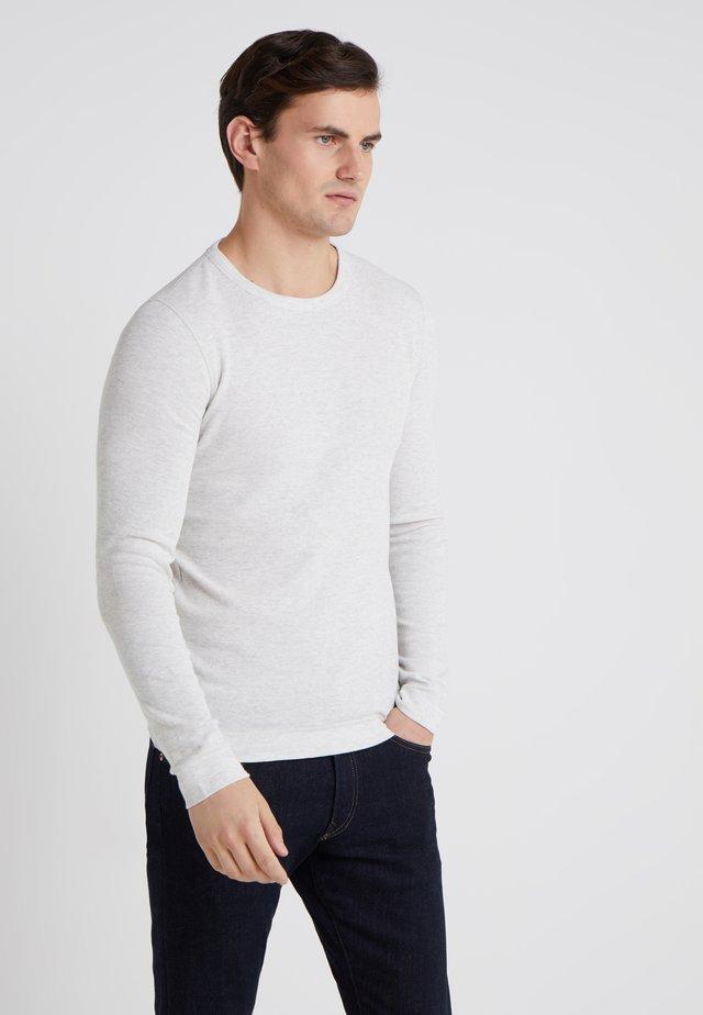 TEMPEST - Stickad tröja - natural