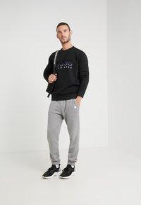 BOSS - WEAVER - Sweatshirt - black - 1