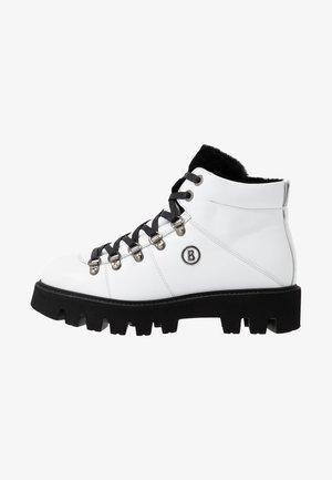 COPENHAGEN - Ankle boots - white