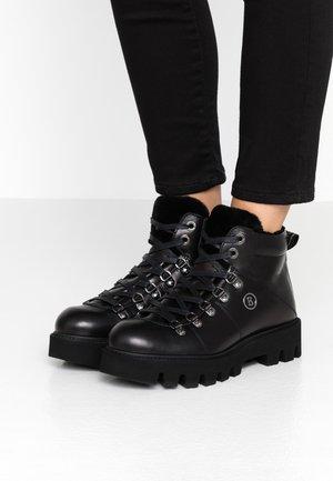 COPENHAGEN - Ankle boot - black