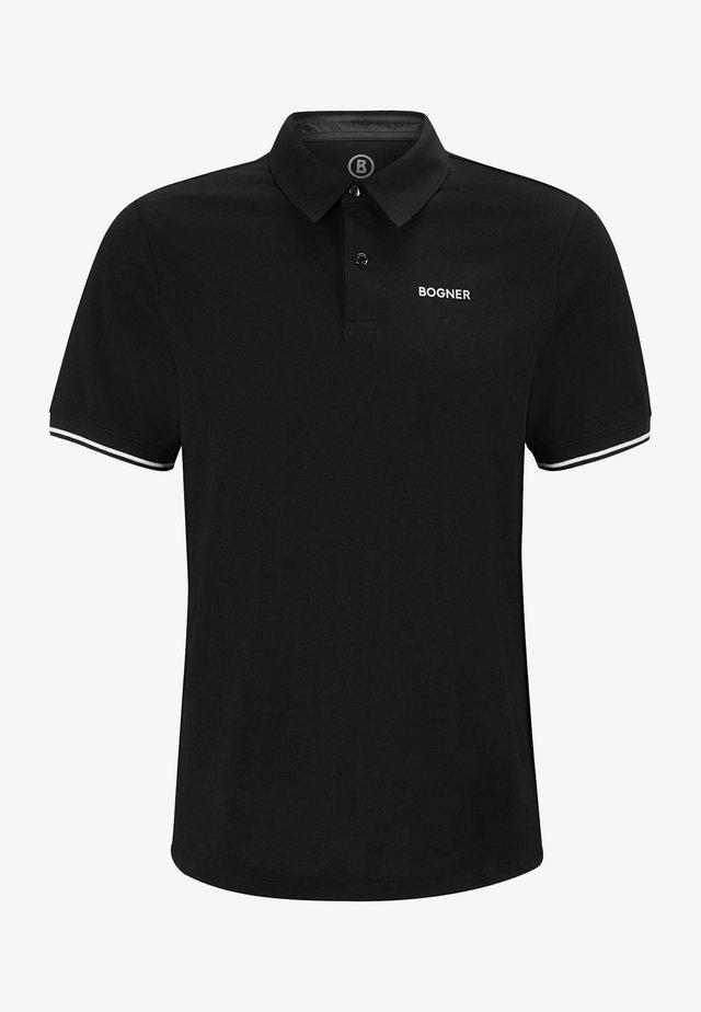 LAGOS - Polo shirt - schwarz