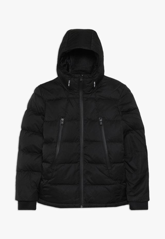 Gewatteerde jas - schwarz